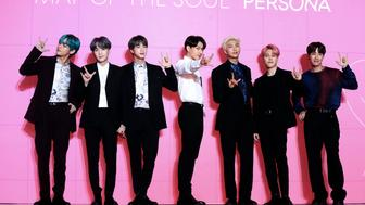 "Members of South Korean K-Pop group BTS pose for photos during a press conference to introduce their new album ""Map of the Soul: Persona"" in Seoul, South Korea, Wednesday, April 17, 2019. (Jo Soo-jung/Newsis via AP)"