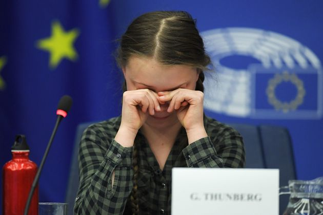 Swedish climate activist Greta Thunberg reacts during a debate with the EU Environment, Public Health...
