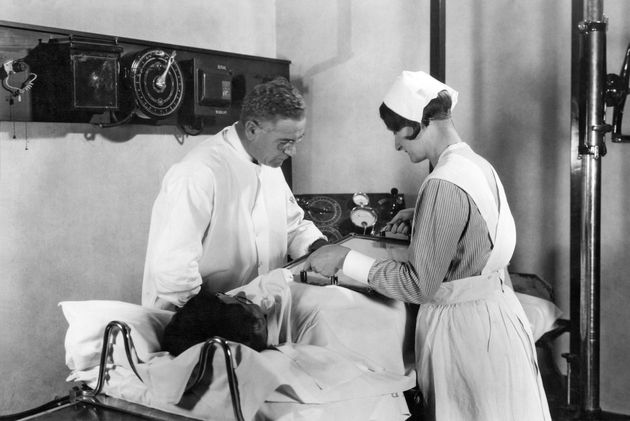 A doctor and nurse examine a patient's stomach in 1928 at John Harvey Kellogg's Battle Creek Sanitarium...