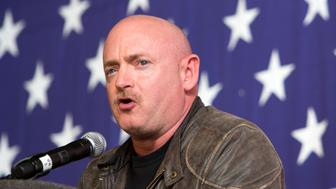 Mark Kelly, husband of Ret. U.S. Rep. Gabby Giffords (D-Ariz.), speaks Sunday, Oct. 27, 2013, during the Bruce Blues & BBQ fundraiser for the Bruce Braley senate campaign at the Iowa State Fairgrounds in Des Moines, Iowa. (AP Photo/Scott Morgan)