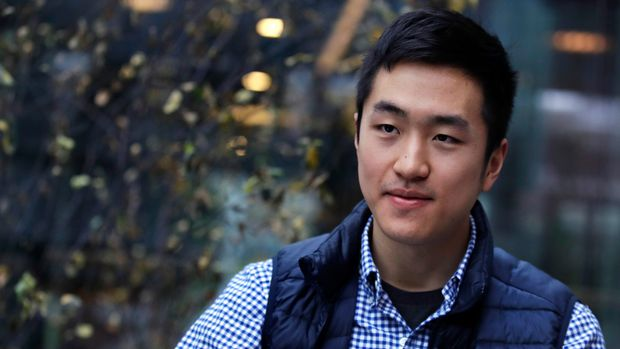 CORRECTS NUMBER OF OTHER RHODES SCHOLAR FROM 30 TO 31 -Harvard University graduate Jin K. Park, who holds a degree in molecular and cellular biology, listens during an interview in Cambridge, Mass., Thursday, Dec. 13, 2018. Park, who was named a Rhodes Scholar along with 31 other Americans in November, entered the U.S. illegally as a child, moving to Queens borough of New York City with his family. The undocumented student, who participates in the Deferred Action for Childhood Arrivals program (DACA), is not sure if he'll be allowed back in the U.S. after his studies in the United Kingdom. (AP Photo/Charles Krupa)