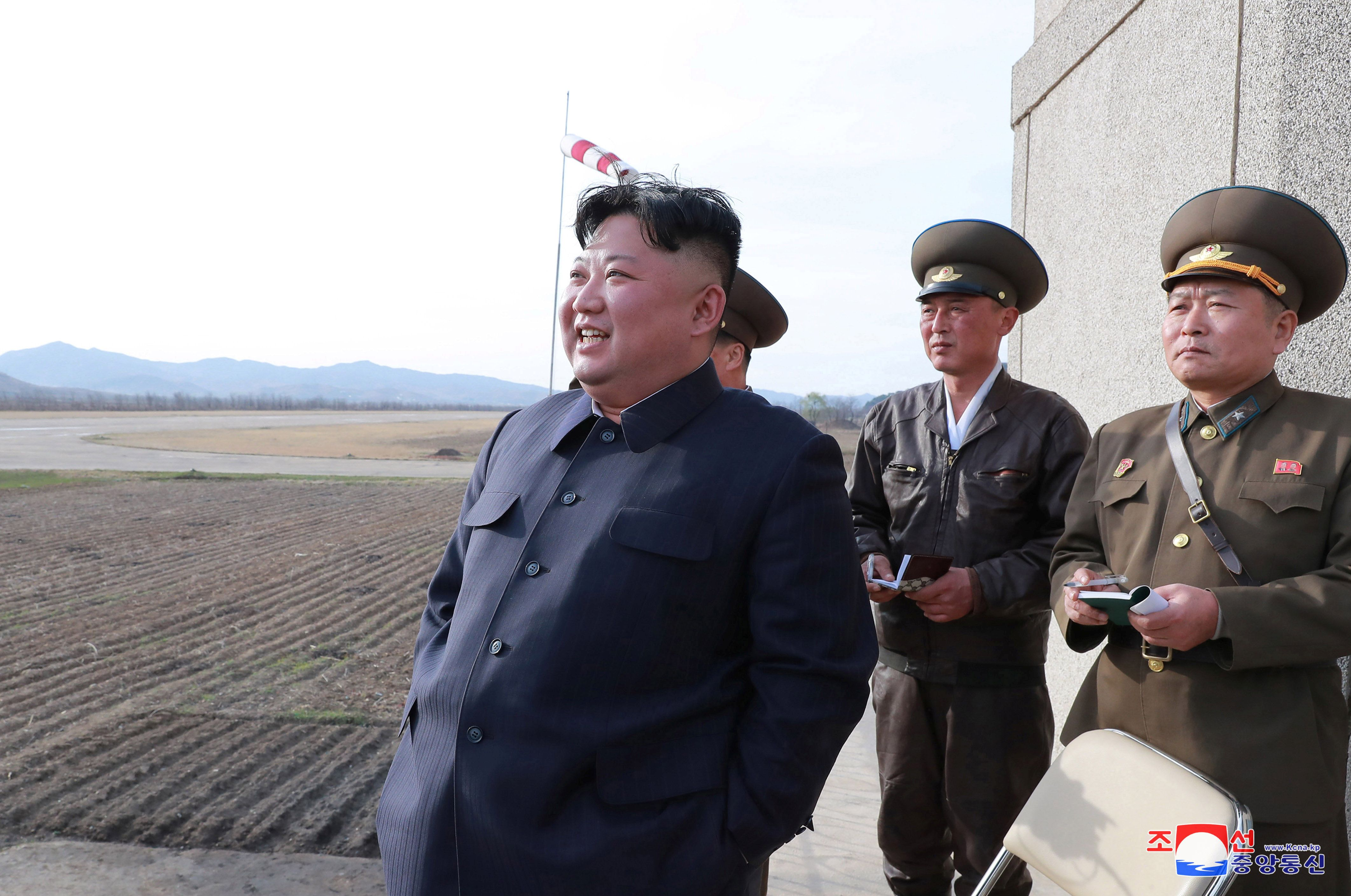 North Korean leader Kim Jong Un gives guidance while attending a flight training of the Korean People's Army Air Force at an