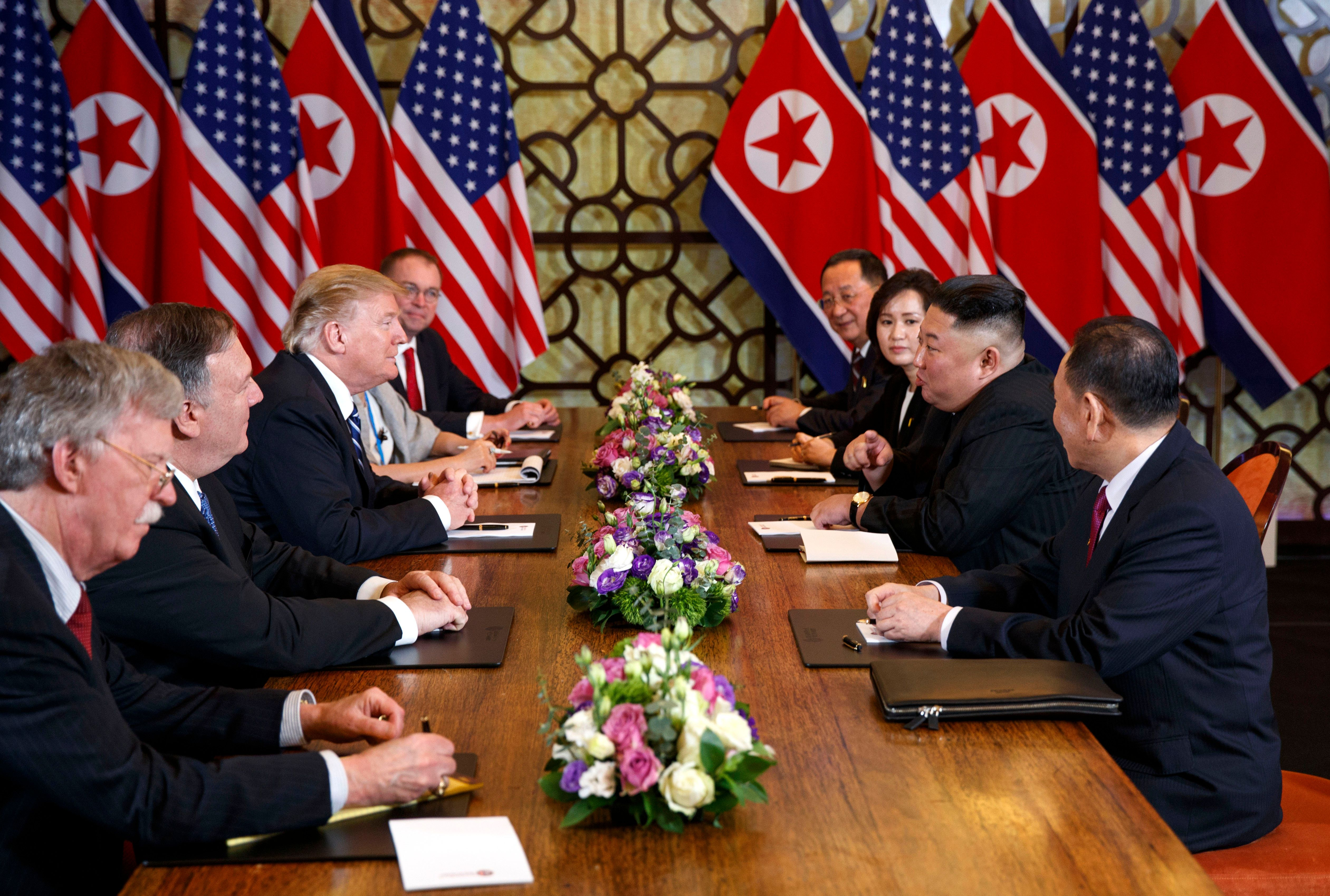 President Donald Trump, third from left, speaks with Secretary of State Mike Pompeo, second from left, during a meeting with