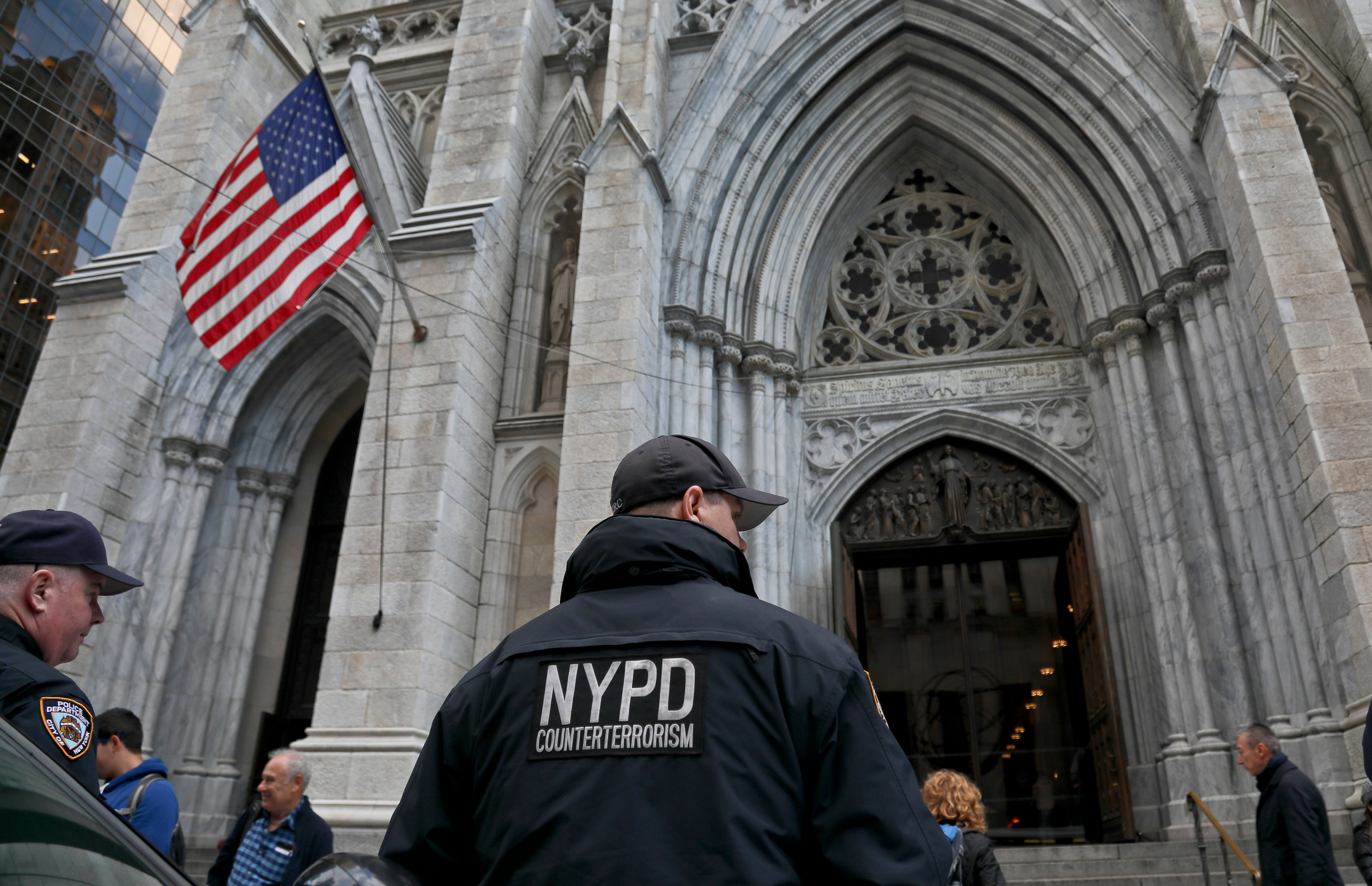 NYPD counterterrorism officers are stationed at St. Patrick's Cathedral, as religious institutions boost security in the aftermath of Pittsburgh's Synagogue shooting, Monday Oct. 29, 2018, in New York. (AP Photo/Bebeto Matthews)