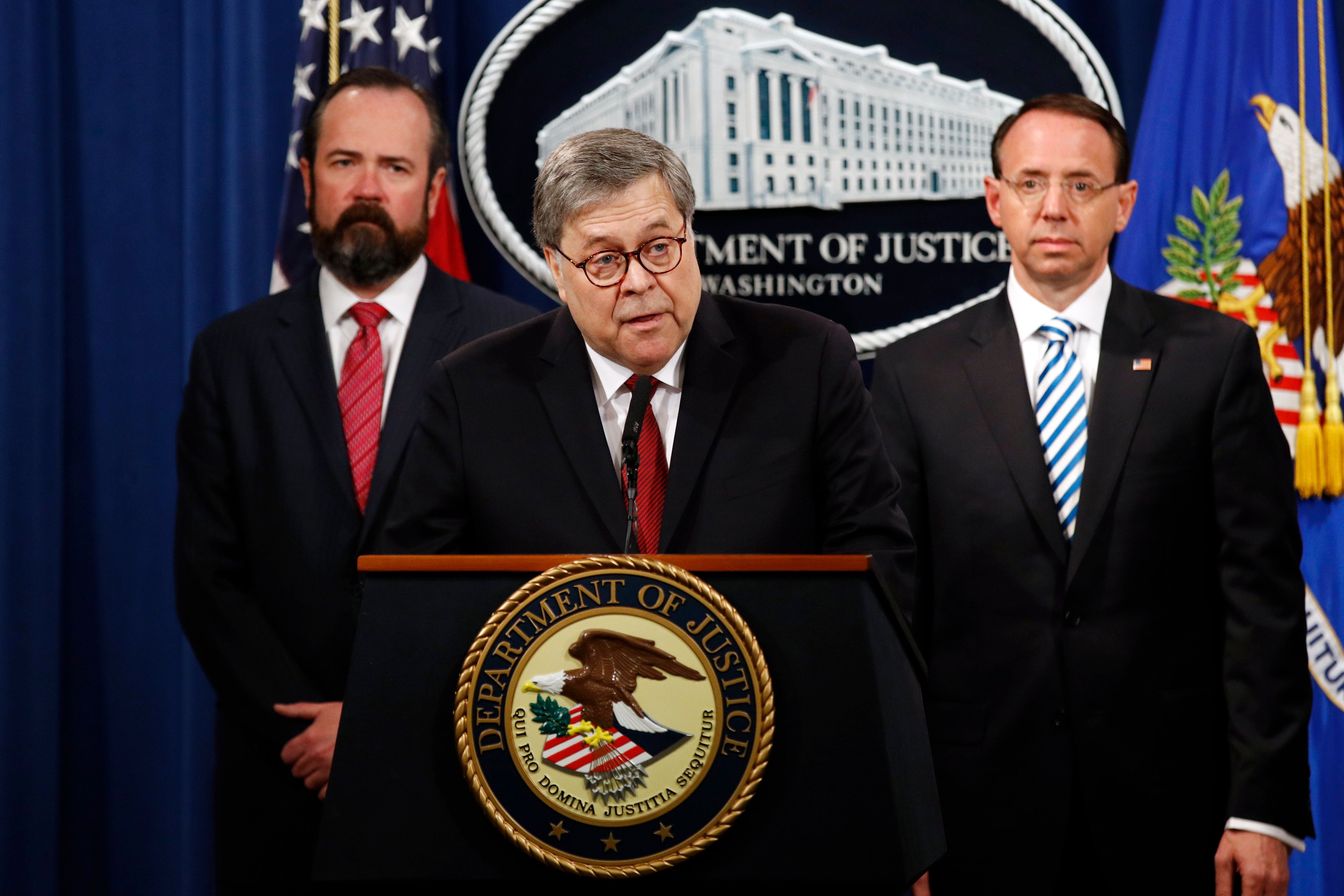 Attorney General William Barr speaks alongside Deputy Attorney General Rod Rosenstein, right, and Deputy Attorney General Ed O'Callaghan, left, about the release of a redacted version of special counsel Robert Mueller's report during a news conference, Thursday, April 18, 2019, at the Department of Justice in Washington. (AP Photo/Patrick Semansky)