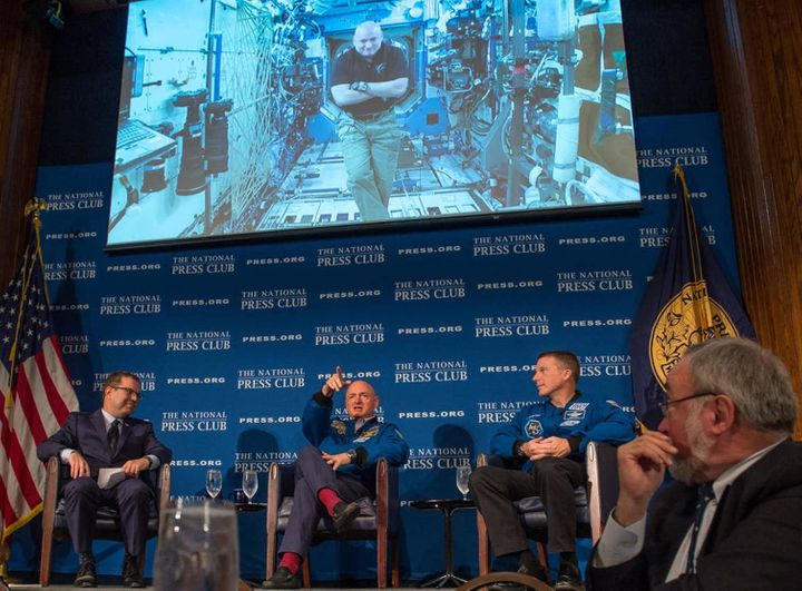 One day before astronaut Scott Kelly reaches the six-month mark in space, he talks live from onboard the ISS with John Hughs,