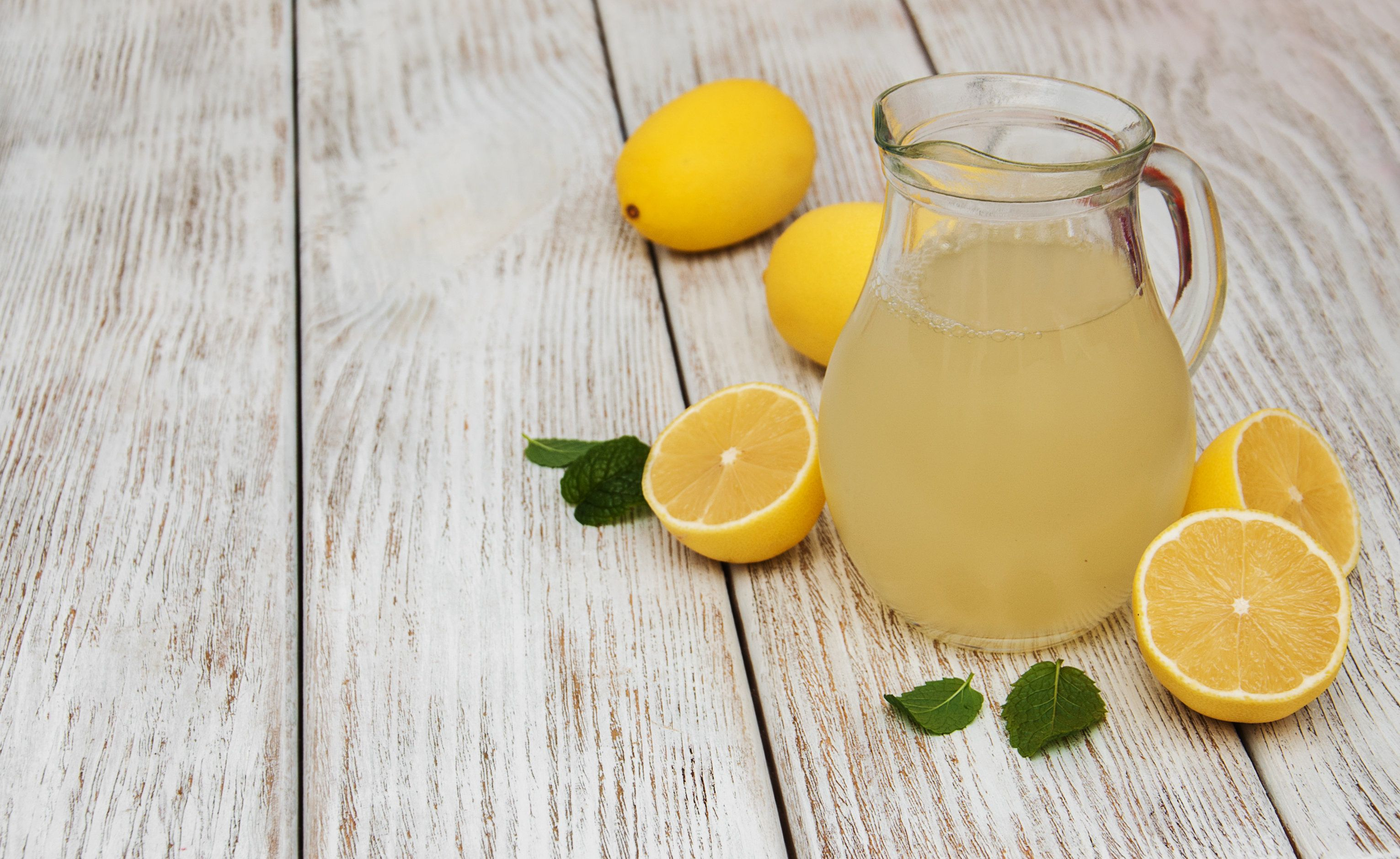 Jar of lemon juice on a old wooden table