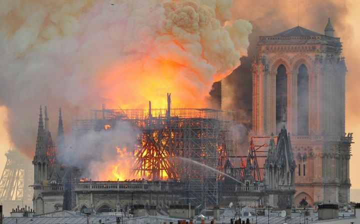Flames and smoke rise as fire rages in the Notre Dame Cathedral in Paris.