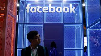 A Facebook sign is seen during the China International Import Expo (CIIE), at the National Exhibition and Convention Center in Shanghai, China November 5, 2018. REUTERS/Aly Song