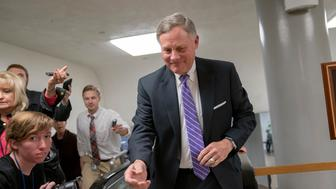 Senate Intelligence Committee Chairman Richard Burr, R-N.C., heads to the Senate as reporters ask about reports that his panel's investigation has found no direct evidence of a conspiracy between President Donald Trump's campaign and Russia, at the Capitol in Washington, Tuesday, Feb. 12, 2019. (AP Photo/J. Scott Applewhite)