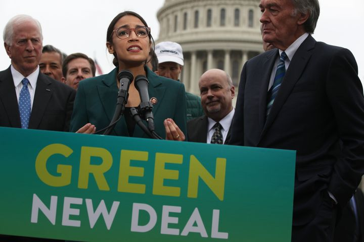 Rep. Alexandria Ocasio-Cortez and Sen. Ed Markey (far right) unveil their resolution for a Green New Deal in Washington in Fe