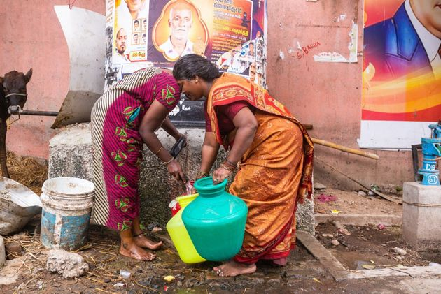Kannika Arumugam collecting water from the local pump near her home in Chennai,