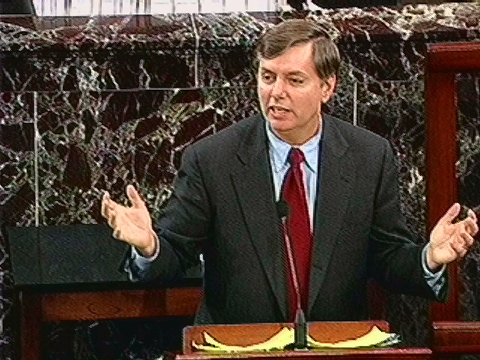 House Manager Lindsey Graham, R-S.C. gestures during the Senate impeachment trial of President Clinton Saturday, Feb. 6, 1999. Graham was summarizing the differences between the House Managers presentation of witnesses and that of the defense.  (AP Photo/APTN)
