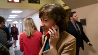 Sen. Susan Collins, R-Maine, arrives in the Senate where she has said she will vote for a resolution to annul President Donald Trump's declaration of a national emergency at the southwest border, on Capitol Hill in Washington, Thursday, March 14, 2019. (AP Photo/J. Scott Applewhite)
