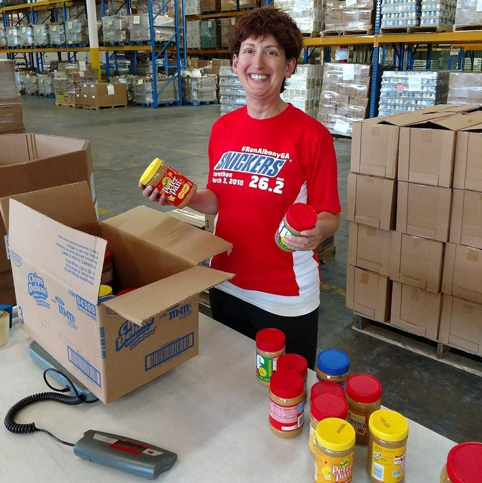 Boxing up peanut butters after a very successful food drive. Nut butters are a high-demand item, especially for kids, families and seniors.