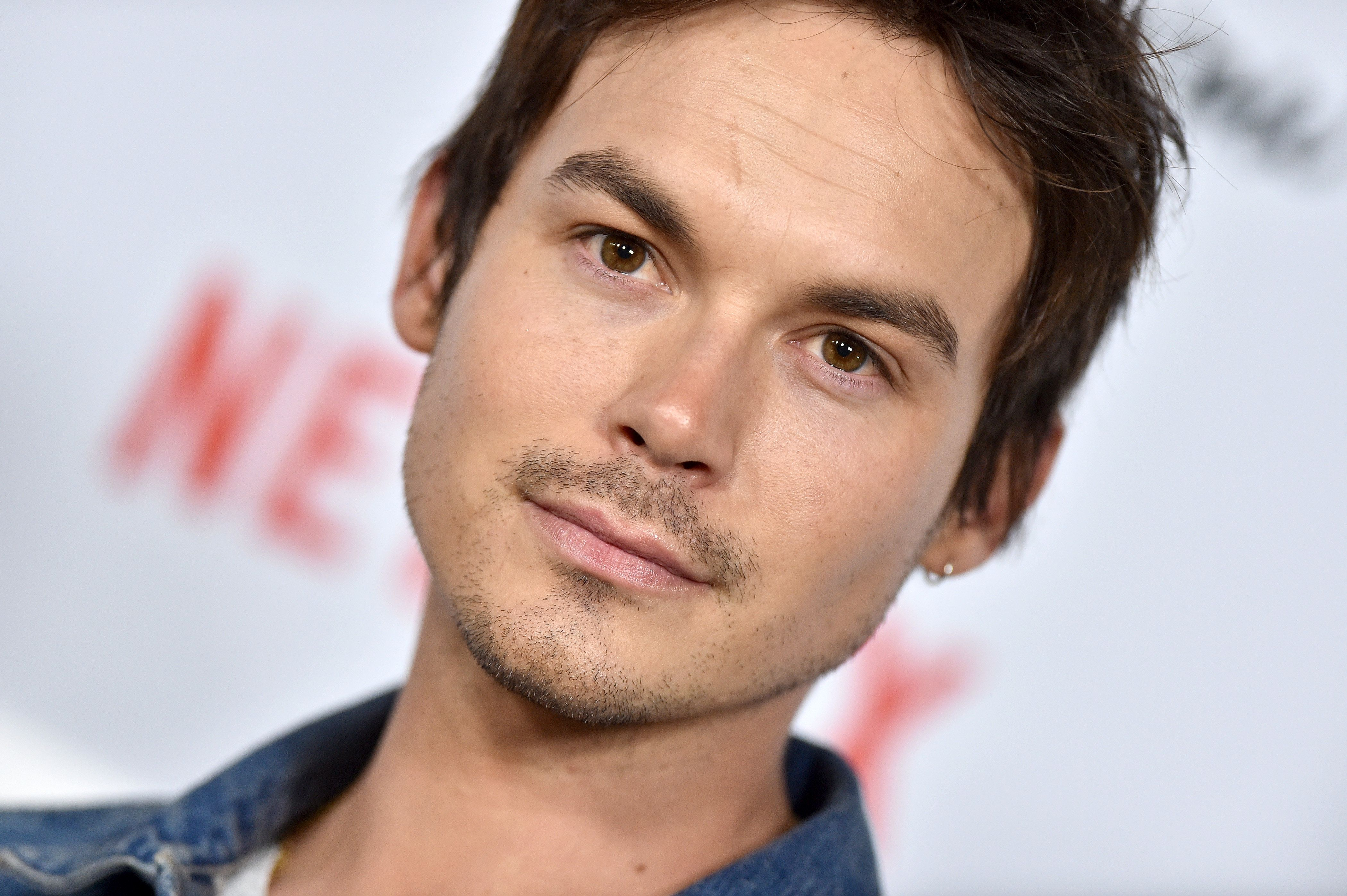 """Actor Tyler Blackburn says he initially felt pressure to adhere to """"gay"""" or """"straight"""" labels, even though he identified with"""