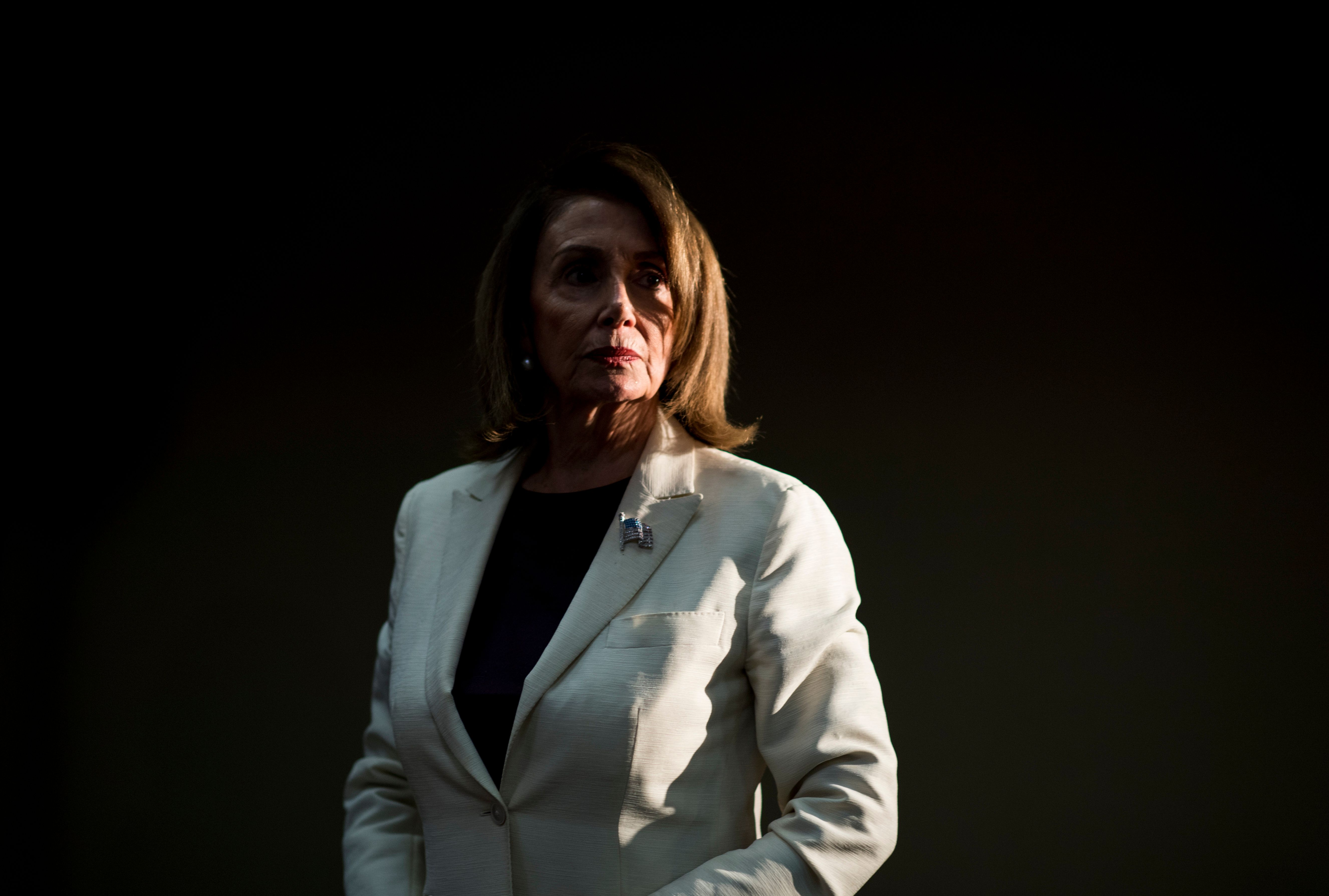UNITED STATES - APRIL 10: Speaker of the House Nancy Pelosi, D-Calif., stands off to the side as other leaders speaks at the House Democrats'  2019 Issues Conference opening press conference at the Landsdowne Resort and Spa in Leesburg, Va., on Wednesday, April 10, 2019. (Photo By Bill Clark/CQ Roll Call)