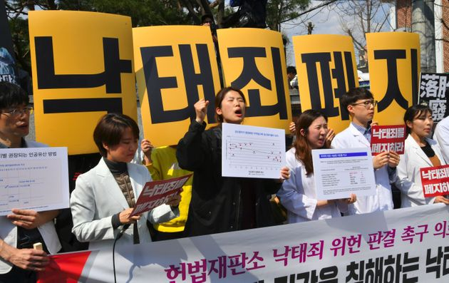 South Korean women's rights activists hold a rally against the abortion ban outside the Constitutional...