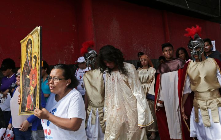 Jose Fuentes, center, portrays Jesus Christ during a Good Friday procession in Panama City on April 19, 2019.