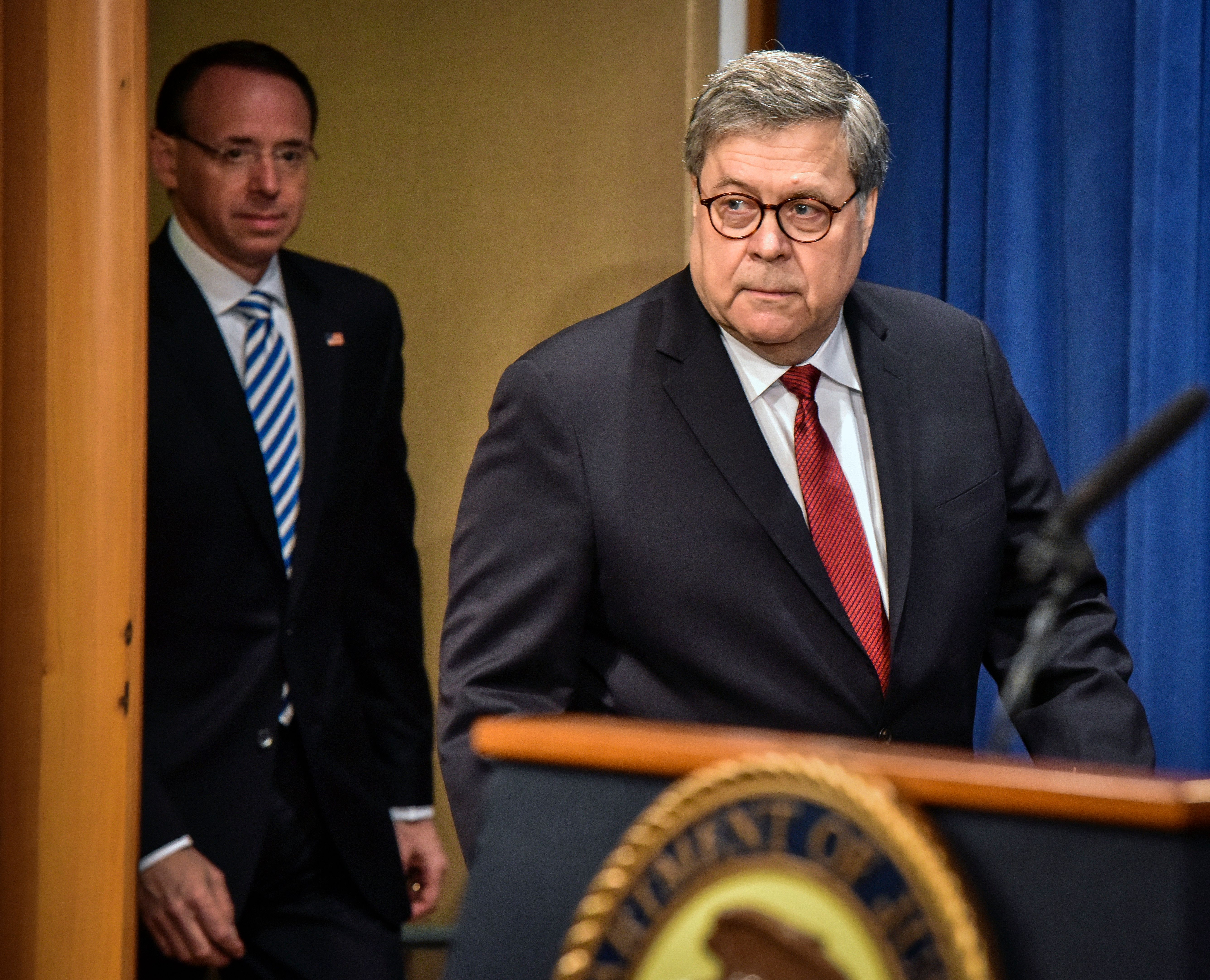 WASHINGTON, DC - APRIL 18: Attorney General William Barr, followed by Deputy AG Rod Rosenstein, left, arrives for a press conference hours before releasing a lightly redacted version of the Mueller report, on April, 18, 2019 in Washington, DC. (Photo by Bill O'Leary/The Washington Post via Getty Images)