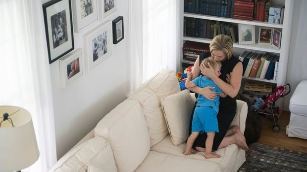 AMITYVILLE, NY - JULY 24: Congressional candidate Liuba Grechen Shirley takes a break from shooting her campaign ad to share a moment with her son, Nicholas on July 24, 2018 in her Amityville home. (Michael Noble, Jr. for The Washington Post via Getty Images)