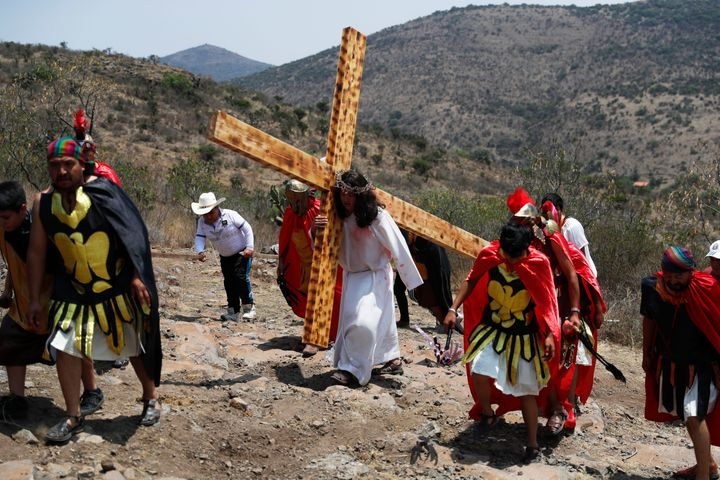 People reenact the crucifixion of Jesus on Good Friday on a hill outside the village of San Mateo, Tepotzotlán, Mexico