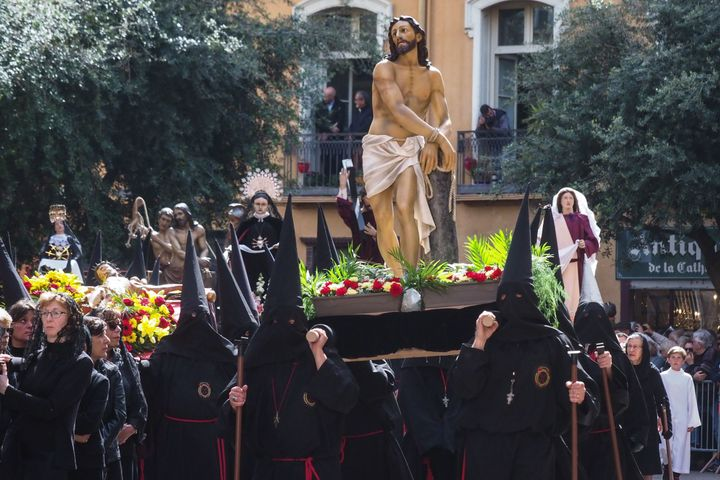 A group of penitents takes part in a traditional Catalan Good Friday procession in the center of Perpignan, southwestern Fran