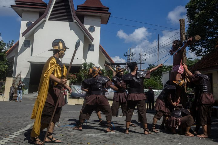 Christians reenact the crucifixion of Jesus in Surabaya, East Java.