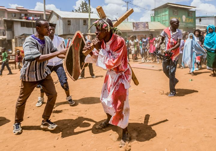 Christian devotees reenact the Way of the Cross, or Jesus Christ's passion, during a Good Friday commemoration in Kibera, Nai