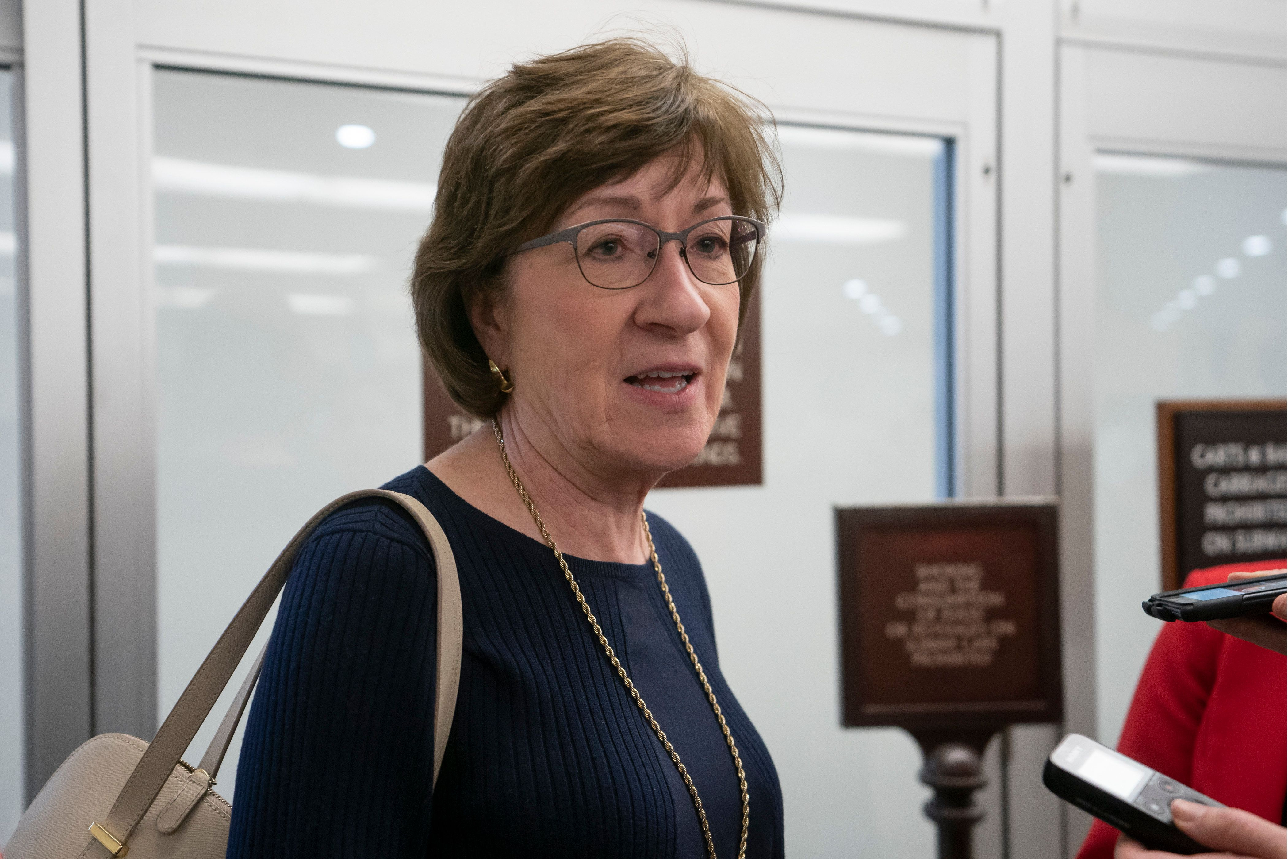 Sen. Susan Collins, R-Maine, takes questions from reporters after the confirmation vote for David Bernhardt to serve as secretary of the Interior, at the Capitol in Washington, Thursday, April 11, 2019. (AP Photo/J. Scott Applewhite)