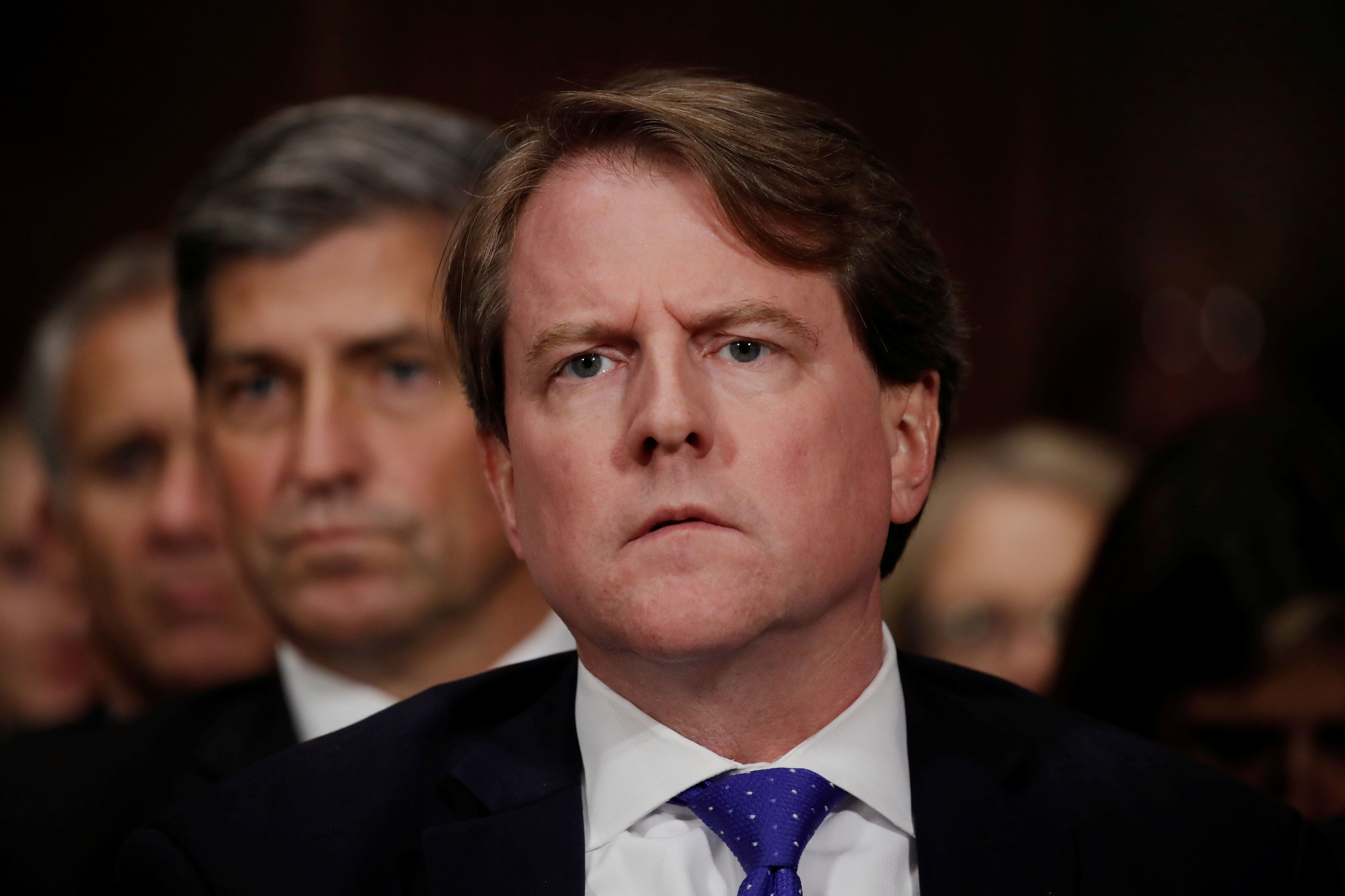 White House counsel Don Mcgahn listens to U.S. Supreme Court nominee Brett Kavanaugh testify before a Senate Judiciary Committee confirmation hearing on Capitol Hill in Washington, U.S., September 27, 2018. REUTERS/Jim Bourg