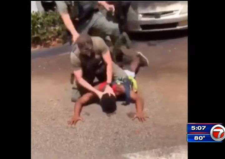 An officer is seen bashing the teenager's head against the concrete before hitting the teen in the head.
