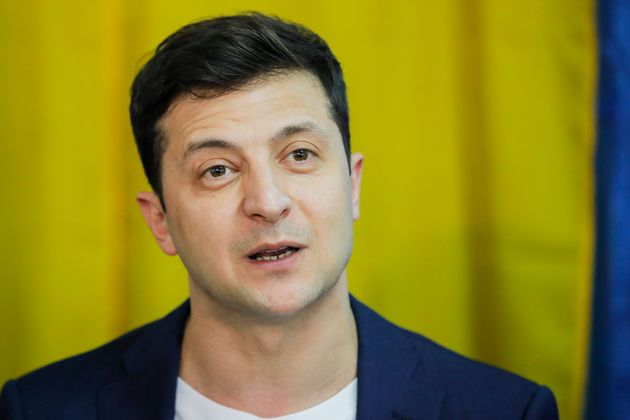 Ukrainian comedian and presidential candidate Volodymyr Zelenskiy speaks to media at a polling station,...