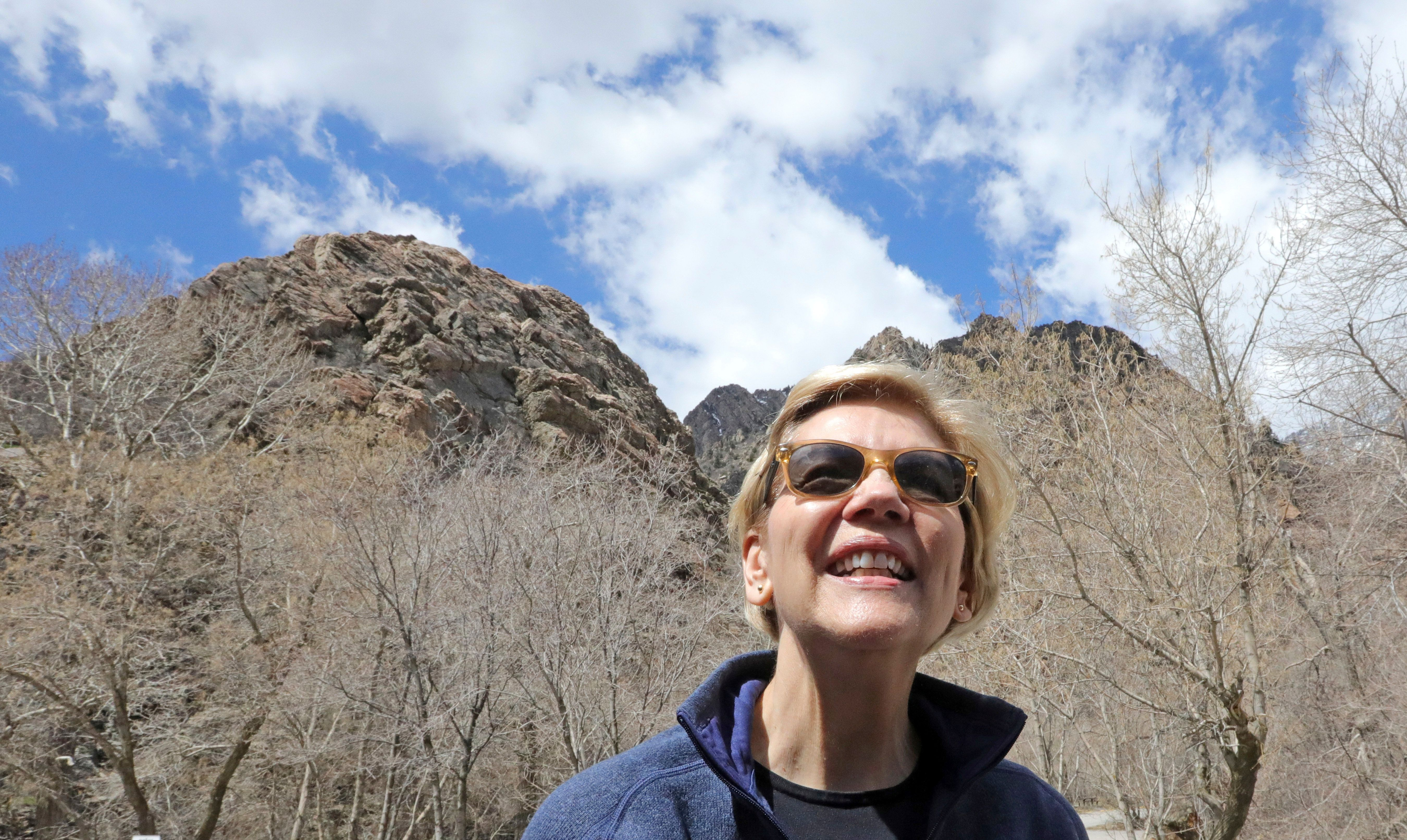Democratic presidential candidate Sen. Elizabeth Warren, D-Mass., visits Big Cottonwood Canyon Wednesday, April 17, 2019, east of Salt Lake City. Warren is in Utah Wednesday after promising to restore broader public lands protections for two of the state's high-profile national monuments if elected president. It's a move that would not endear her to Utah's GOP establishment but could appeal to voters across the West angered by President Donald Trump's decision to shrink the monuments. (AP Photo/Rick Bowmer)