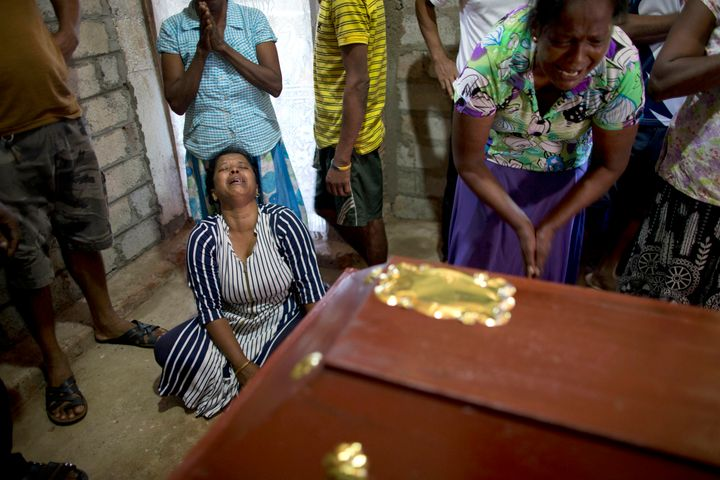 Relatives cry near the coffin for 12-year Sneha Savindi, who was a victim of Easter Sunday bombing at St. Sebastian Church.