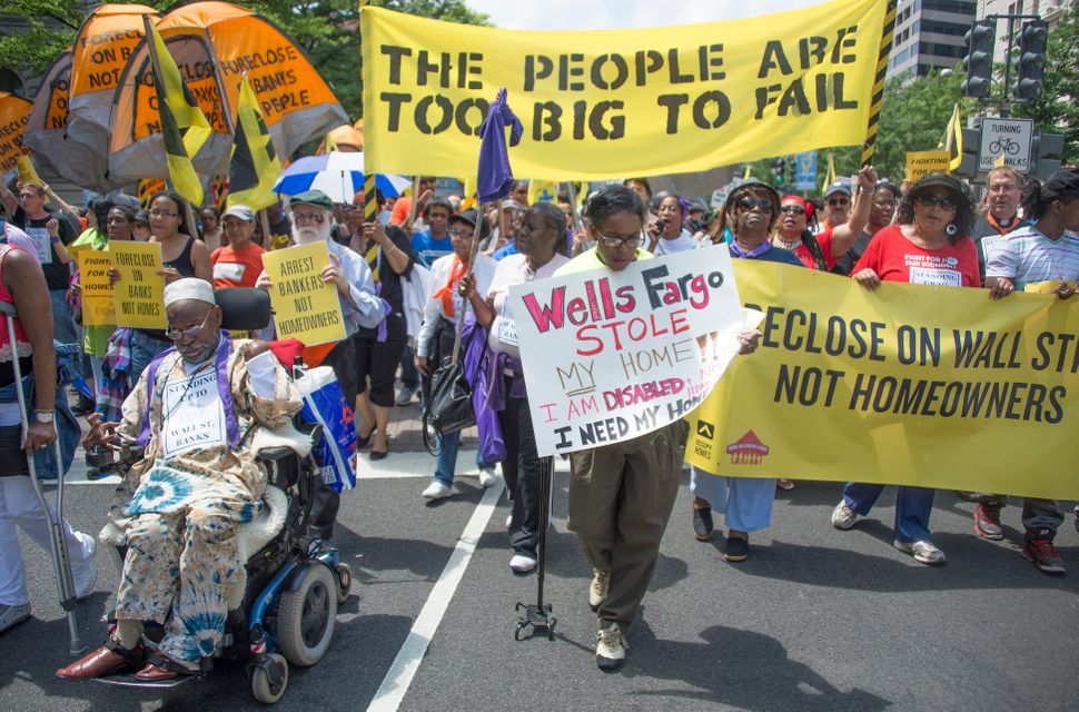 Protesters march to the Department of Justice during a rally against home foreclosures in Washington on May 20, 2013.