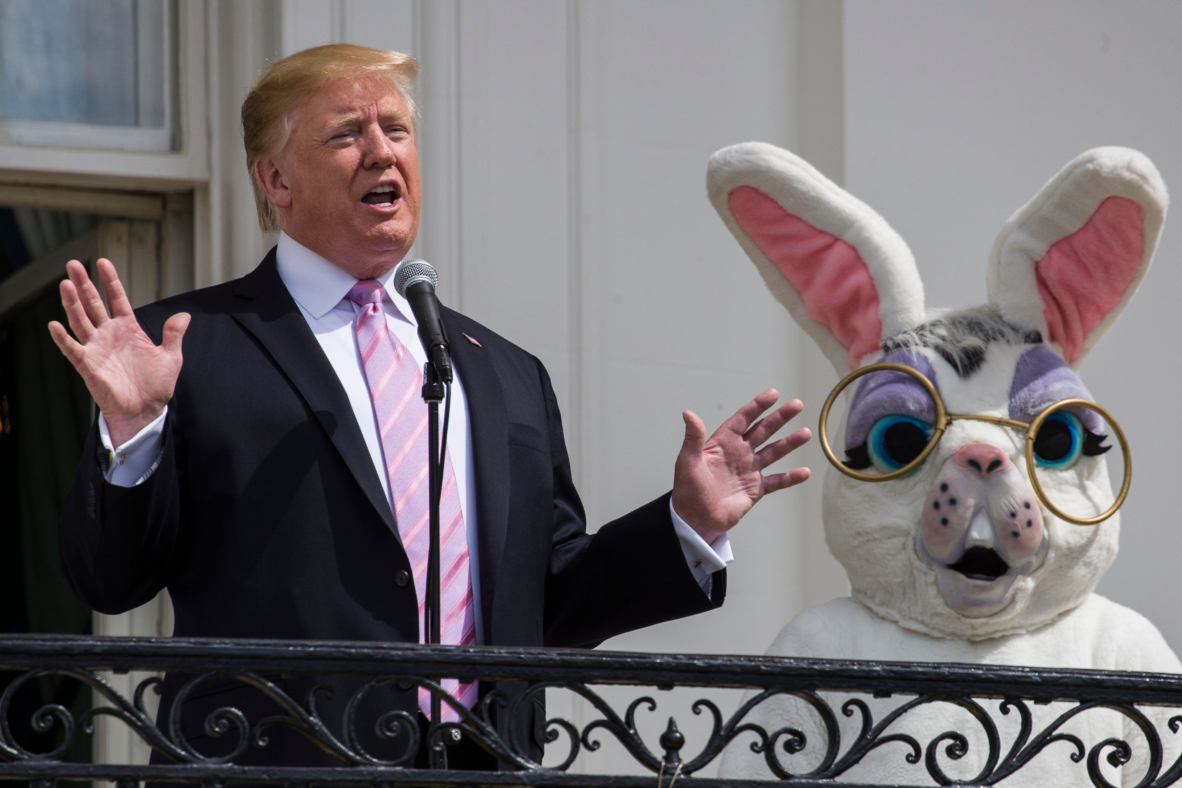 President Donald Trump, joined by the Easter Bunny, speaks from the Truman Balcony of the White House in Washington, Monday, April 22, 2019, during the annual White House Easter Egg Roll. (AP Photo/Alex Brandon)