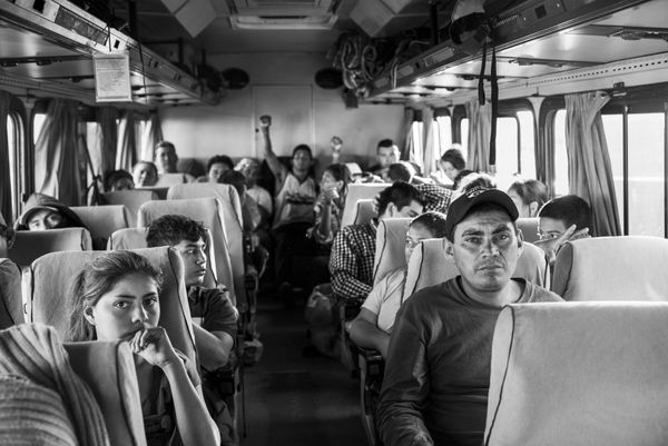 "Migrants from Honduras, El Salvador and Guatamala, also known as ""The Northern Triangle,"" get on a bus in Navojoa"