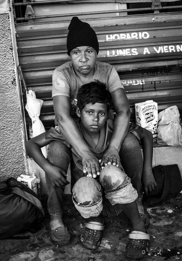 Maria and her son fled Honduras to escape the M13 gang when she was unable to pay her monthly extortion fees.  As a result, g