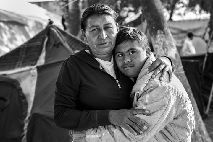 <i>A Mother and Her Son in Tijuana</i><br>Javi, who has Down syndrome, hugs his mother Maria Lucia Cardinas in the Benito Jur