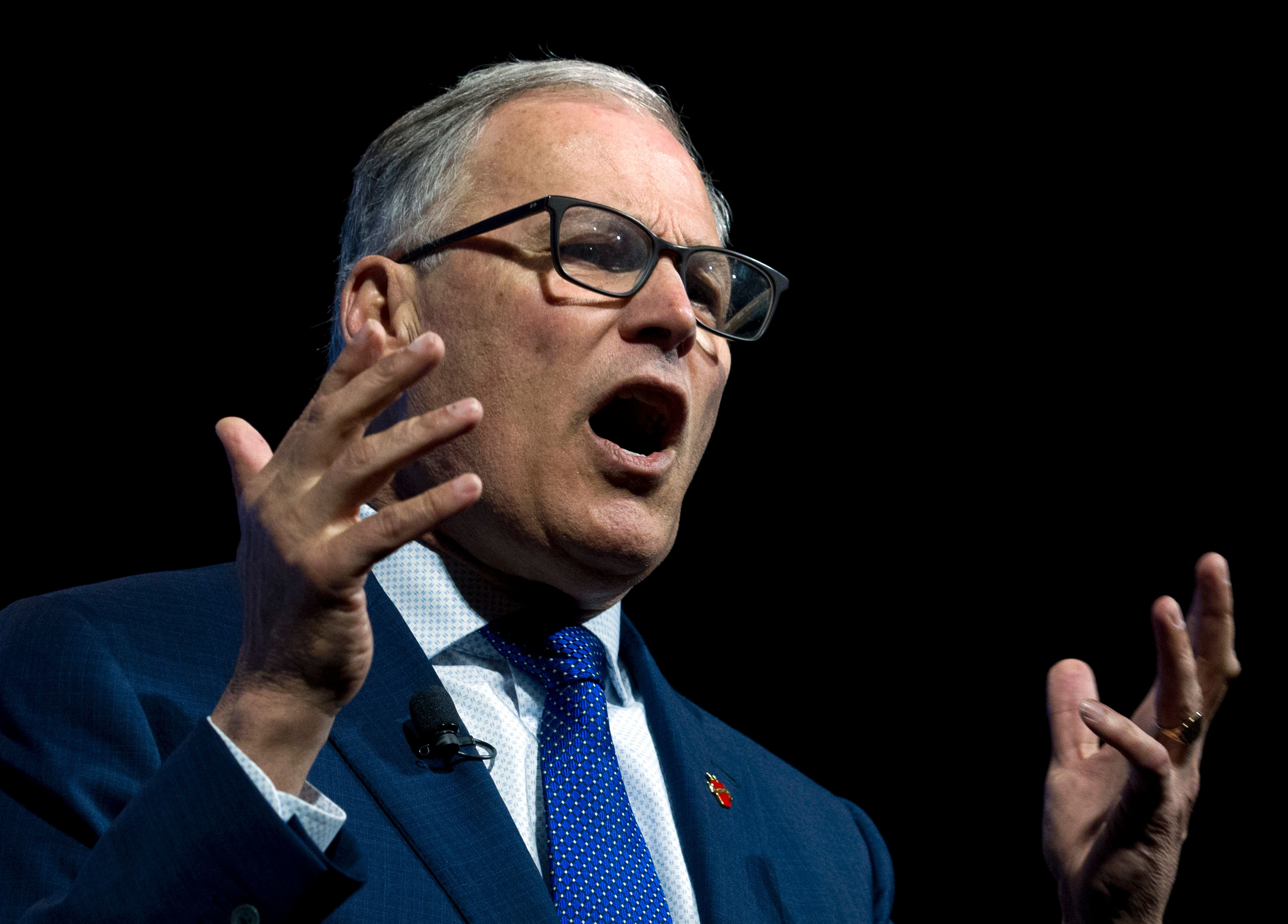 Democratic presidential candidate Washington Gov. Jay Inslee speaks during the We the People Membership Summit, featuring the 2020 Democratic presidential candidates, at the Warner Theater, in Washington, Monday, April 1, 2019. (AP Photo/Jose Luis Magana)
