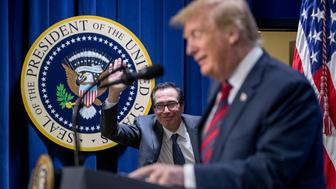 Treasury Secretary Steve Mnuchin jokingly runs back out on stage as President Donald Trump spoke as if he thought he was still standing on stage with him during a Opportunity Zone conference with state, local, tribal, and community leaders South Court Auditorium of the Eisenhower Executive Office Building, on the White House complex, Wednesday, April 17, 2019, in Washington. (AP Photo/Andrew Harnik)