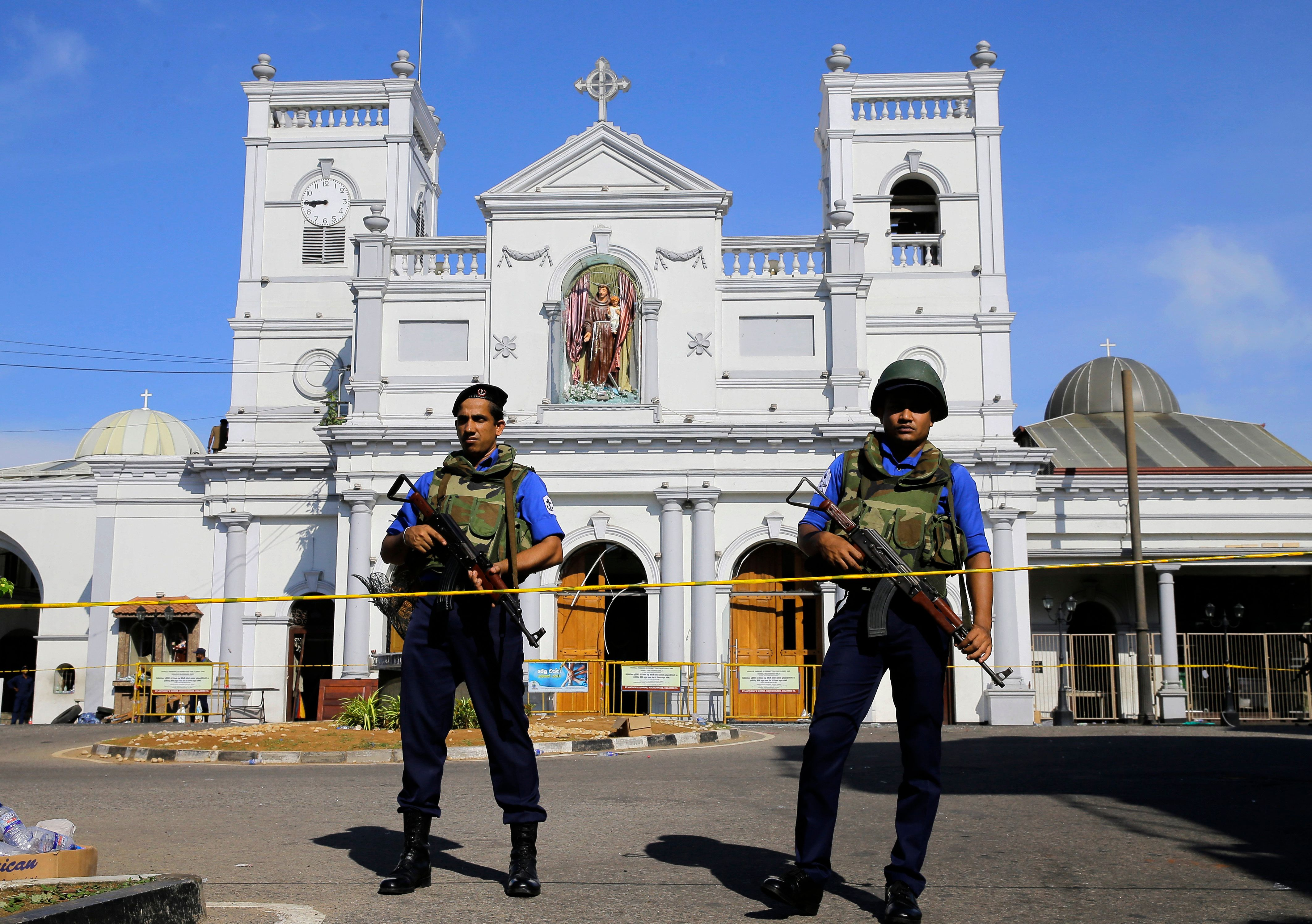 Sri Lankan Navy soldiers stand guard in front of the St. Anthony's Shrine a day after the series of blasts, in Colombo, Sri Lanka, Monday, April 22, 2019. Easter Sunday bombings of churches, luxury hotels and other sites that killed hundreds of people was Sri Lanka's deadliest violence since a devastating civil war in the South Asian island nation ended a decade ago. (AP Photo/Eranga Jayawardena)