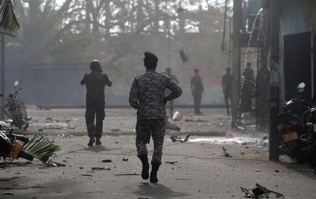 Sri Lankan security forces approach the site after a vehicle parked near St. Anthony's shrine exploded...