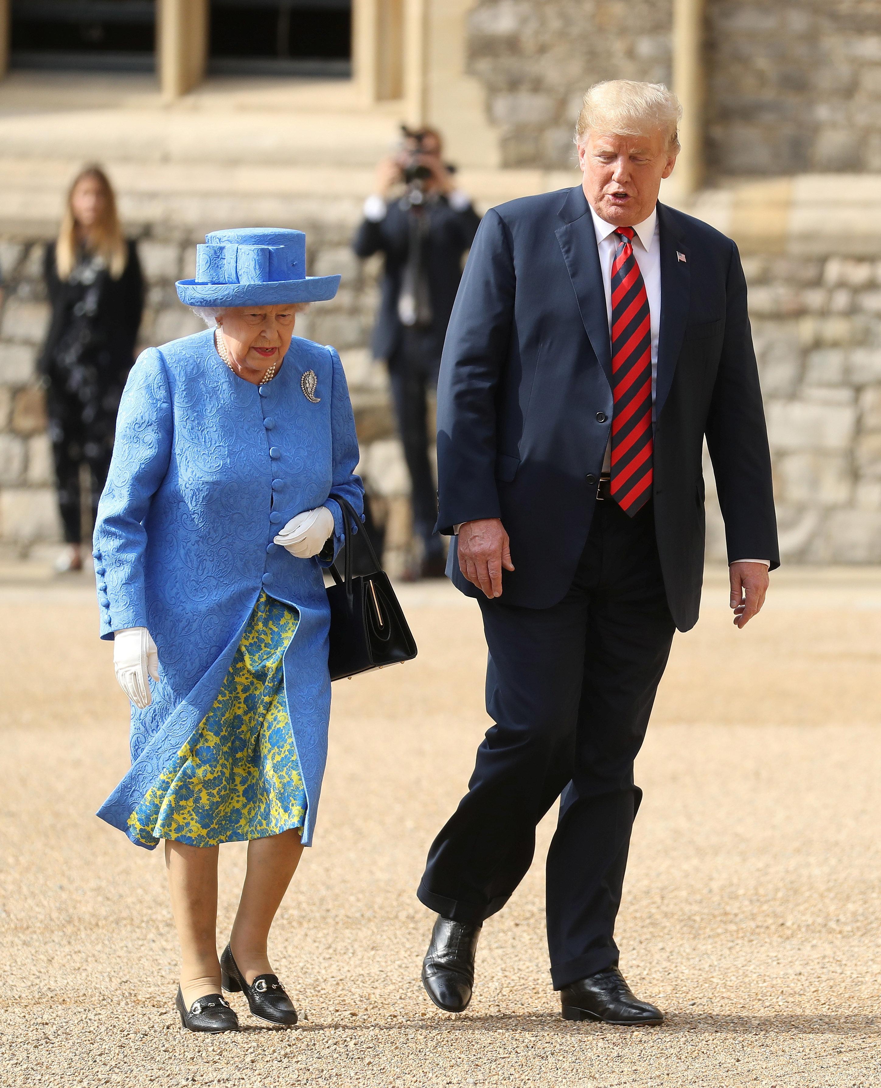 Britain's Queen Elizabeth inspects an honour guard with U.S. President Donald Trump at Windsor Castle, Windsor, Britain July 13, 2018.  Chris Jackson/Pool via REUTERS