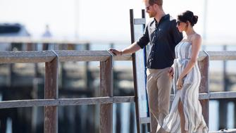 Photo by: KGC-09/STAR MAX/IPx 2018 Prince Harry, The Duke of Sussex and and Meghan, The Duchess of Sussex tour Australia, Fraser Island - 22 Oct 2018. Britain's Prince Harry the Duke of Sussex, and his wife Meghan the Duchess of Sussex, walk towards a meeting with people at Kingfisher Bay Resort on Fraser Island, Australia, 22 October 2018. The Duke and Duchess of Sussex are on a three-week tour of Australia, New Zealand, Tonga, and Fiji and are in Sydney to launch the 2018 Invictus Games, an Olympic-style event for disabled and ill service people.