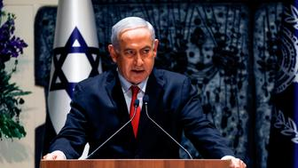 Israeli Prime Minister Benjamin Netanyahu makes an address at the president's residence in Jerusalem on April 17, 2019. - Rivlin on April 17 formally handed Benjamin Netanyahu his letter of appointment to start building a coalition government following last week's elections. In a televised ceremony, Rivlin told Netanyahu that in consultations with all parties elected to the incoming 120-seat parliament, '65 MPs recommended you'. (Photo by MENAHEM KAHANA / AFP)        (Photo credit should read MENAHEM KAHANA/AFP/Getty Images)