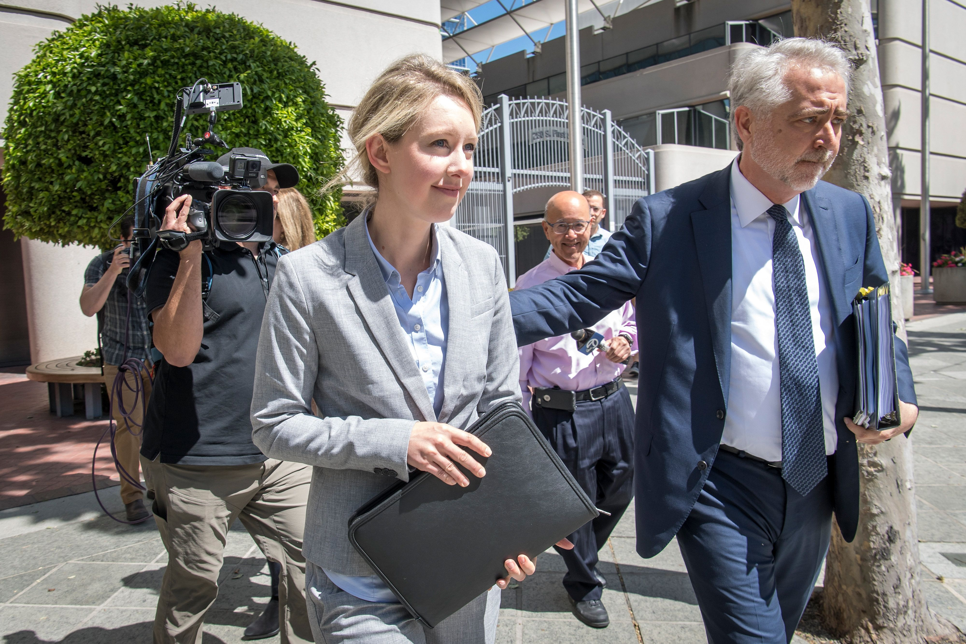 Elizabeth Holmes, founder and former chief executive officer of Theranos Inc., exits federal court in San Jose, California, U.S., on Monday, April 22, 2019. Holmes faces charges of felony conspiracy and fraud, after allegedly misleading patients, health care professionals and investors about her company's blood-testing technology. Photographer: David Paul Morris/Bloomberg via Getty Images