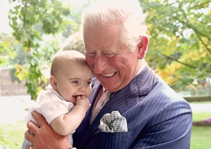 Prince Charles holds grandson Prince Louis at Clarence House on Sept. 5, 2018.