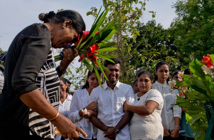Nilanga Anthony, center, mourns the death of her seven-year-old nephew Dhulodh Anthony, onApril 23, 2019 in Negombo, Sr